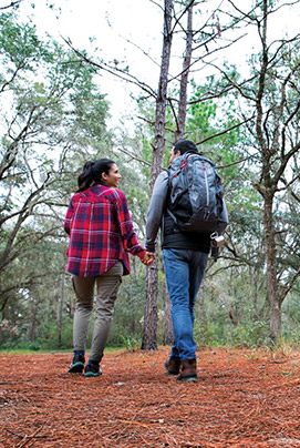 couple hiking through the wooods